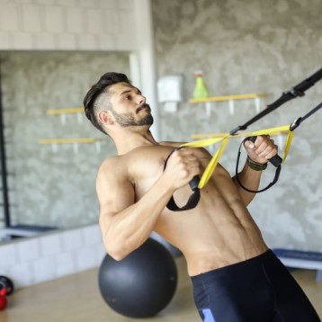 young-muscular-man-exercising-royalty-free-image-692811254-1537995469